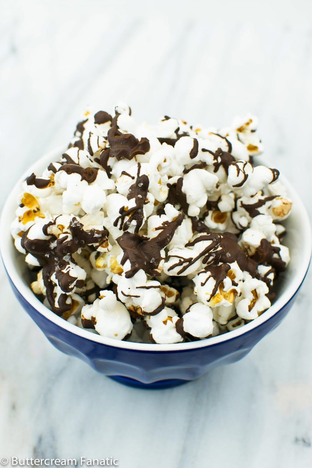Sweet and Savory Chocolate Sea Salt Popcorn made from three simple ingredients. It's a healthy and satisfying gluten-free snack!