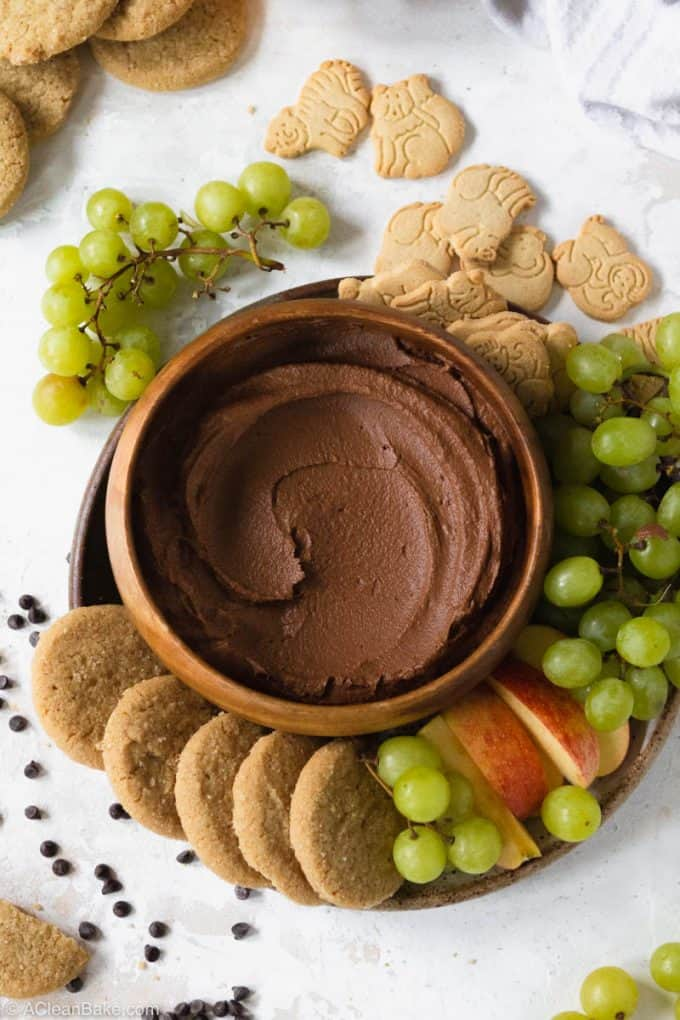 Plate of chocolate dessert hummus surrounded by cookies and fruit