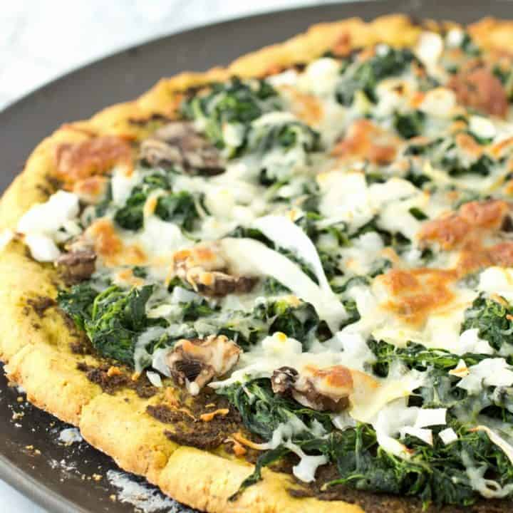 Grain Free Thin Crust Pizza topped with Homemade Pesto and Veggies (gluten-free and paleo)