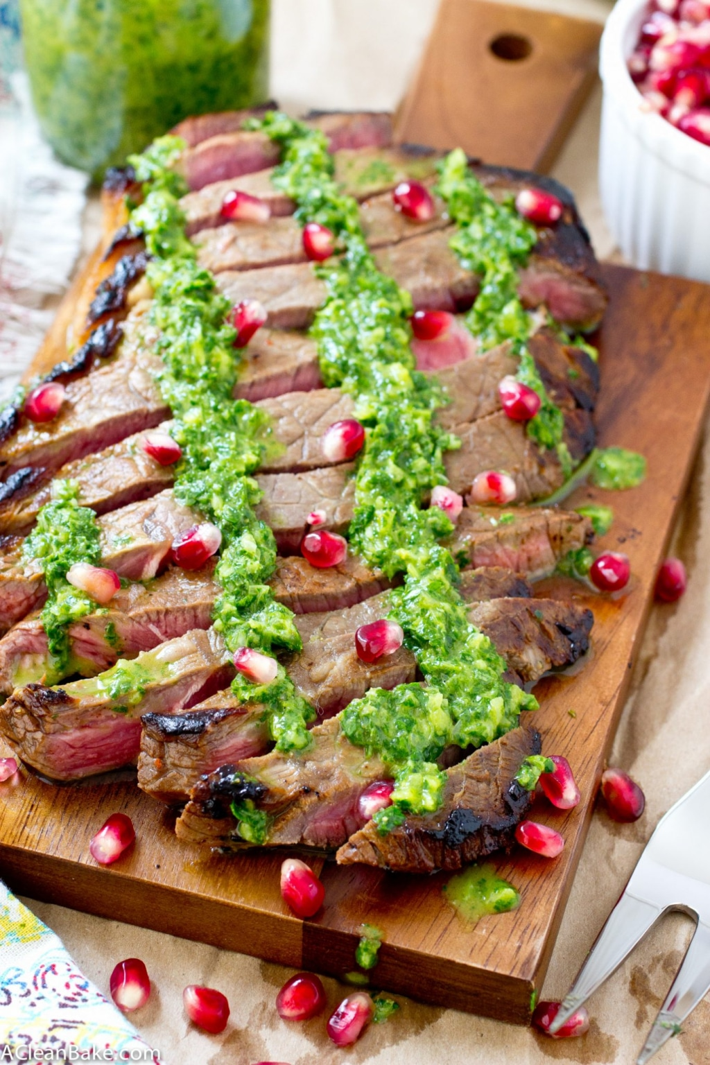 This juicy flank steak is drizzled with homemade chimichurri and plump pomegranate seeds for a simple, flavorful dinner! (gluten free, paleo and low carb)