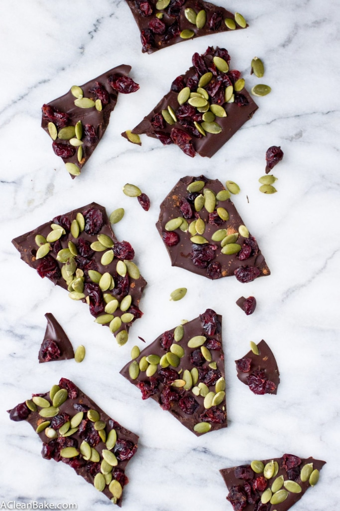 Dark chocolate cranberry pumpkin seed bark tastes just like fall and is super simple to whip up with only 4 ingredients! (gluten free, grain free, paleo, and vegan)