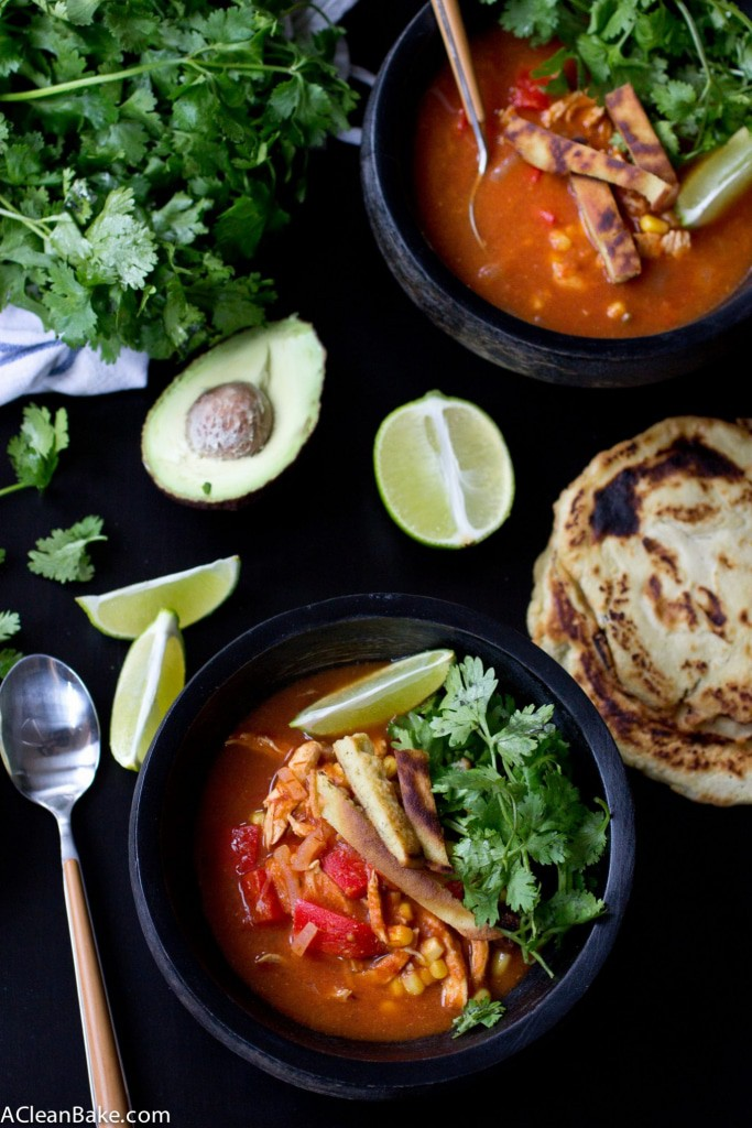 Chicken Tortilla Soup is a family favorite that comes together quickly and easily. Make a pot and have leftovers for a week! This version is topped with gluten free and grain free tortilla strips.