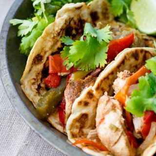 Easy, healthy chicken fajitas that are made in the slow cooker with all-natural (fast and easy) homemade fajita seasoning! (gluten free, grain free, paleo friendly, low carb)