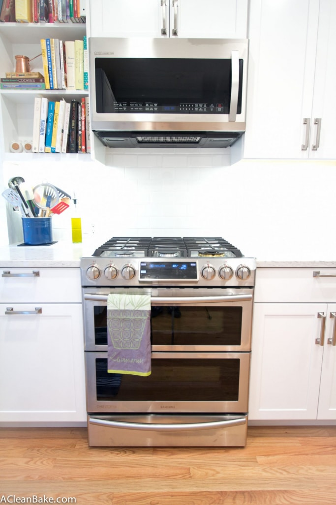 White and Stainless Kitchen with Subway Tile and Marble-Look Countertops (via acleanbake.com)