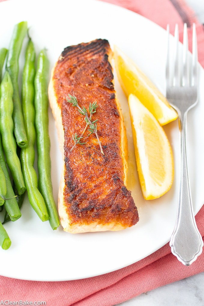 How to Pan Sear Salmon: This easy trick will put homemade seared salmon on your weeknight dinner rotation! #glutenfree #glutenfreedinner #glutenfreedinnerrecipe #paleo #paleodinner #Paleodinnerrecipe #whole30 #whole30dinner #whole30dinnerrecipe #lowcarb #lowcarbdinner #glutenfreedinner #paleodinner #healthy #easydinner #simpledinner