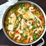 30 Minutes and one pan is all it takes to make paella for dinner tonight! And no, you don't need a special paella pan - don't worry. Bonus: It's naturally gluten free, too!