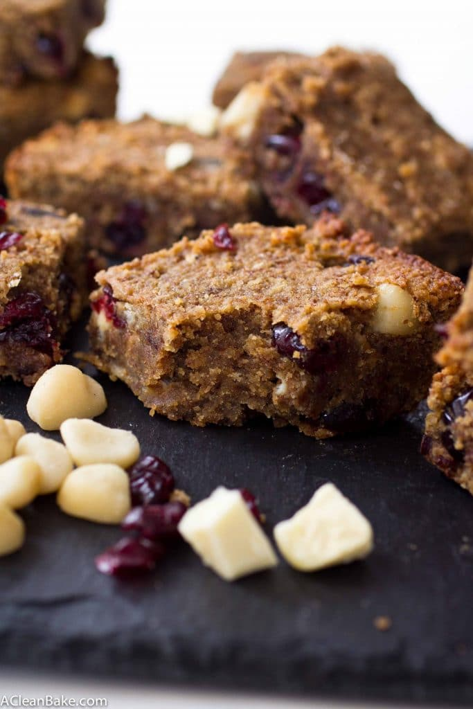 Gooey and decadent cranberry white chocolate macadamia nut blondies. Perfect for Valentine's Day, don't you think? (gluten free, paleo friendly, naturally sweetened, low carb)