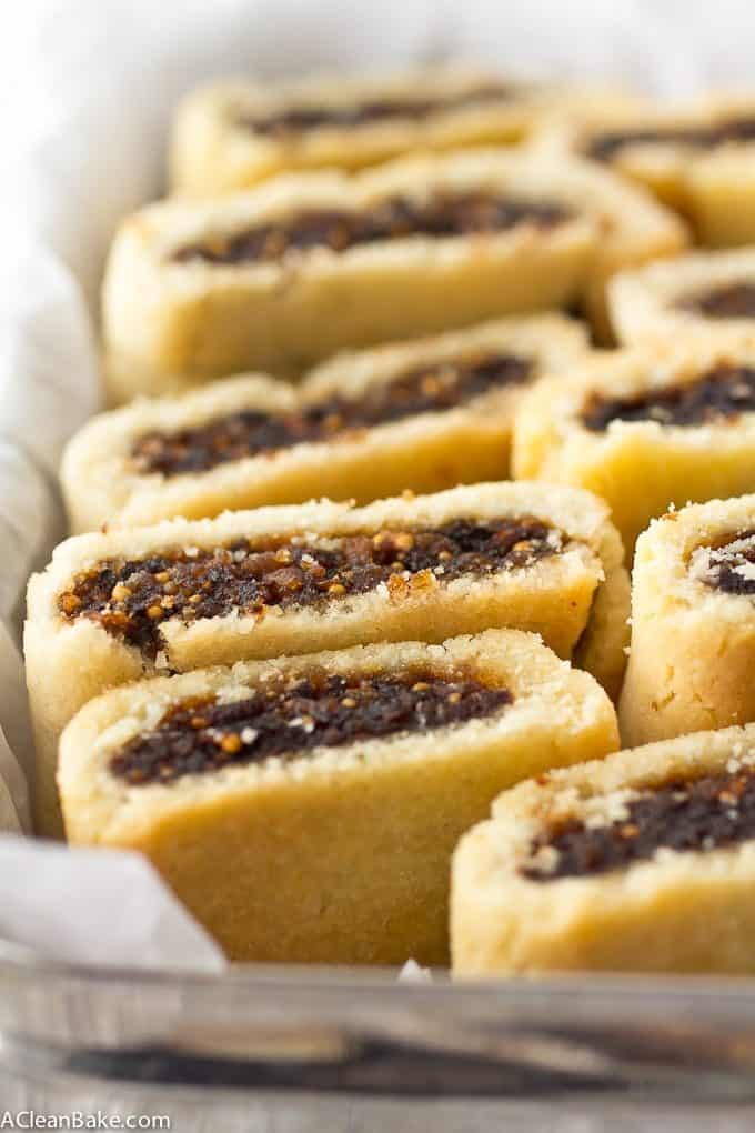 Homemade fig newtons in a pastry box with tissue. This gluten free and paleo fig newton recipe is delicious, all natural, and fun!