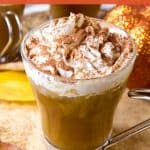 Glass of sugar free pumpkin spice latte with whipped cream and cinnamon on top