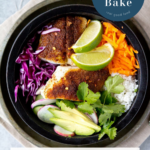 chunks of fish in a bowl with rice, cilantro, purple cabbage and lime
