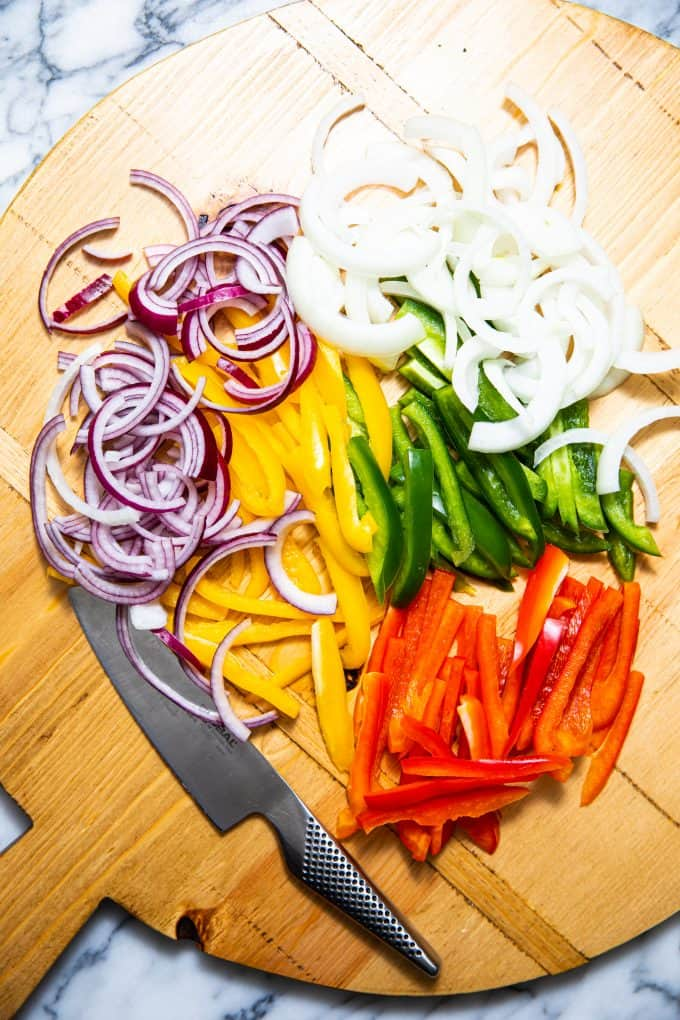 Ingredients on a cutting board for slow cooker crockpot chicken fajitas