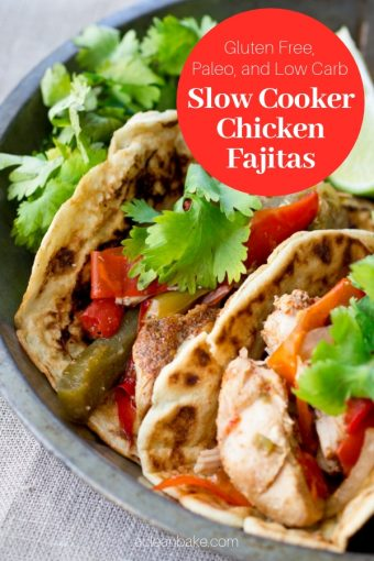 Two slow cooker chicken fajitas in gluten free and paleo tortillas with a garnish of cilantro
