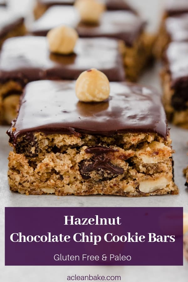 These Hazelnut Chocolate Chip Cookie Bars are so easy to make and taste like a classic chocolate chip cookie studded with rich hazelnuts and pools of chocolate! They're perfect for the holidays or any time. The recipe is healthier too: it's #glutenfree, #paleo, #dairyfree, and #naturallysweetened with no refined #sugar! #recipe #cookie #bar #chocolate #christmas #holiday #cookieexchange #ganache #sweets #dessert