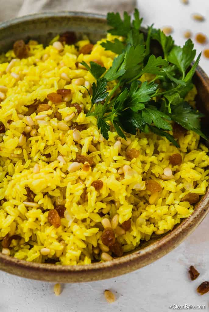 Turmeric rice with nuts and raisins in a bowl