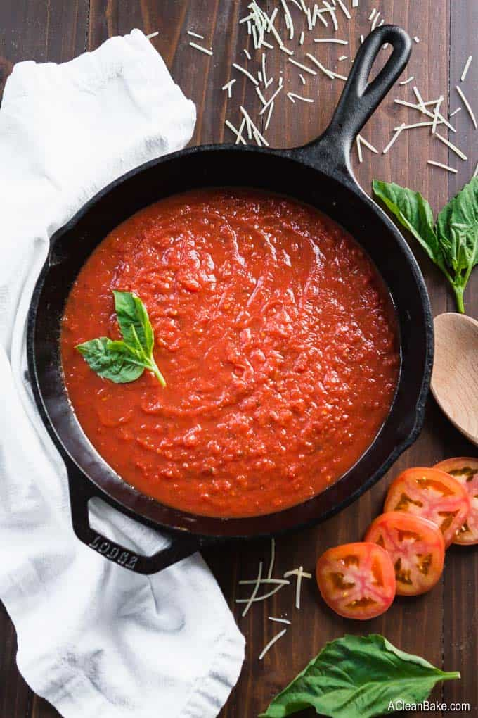 Throwing together a quick marinara sauce is the easiest way to spruce up dinner. When you have to get dinner on the table STAT, start with this #glutenfree, #paleo, #vegan, and #Whole30 friendly sauce! #glutenfreerecipe #glutenfreedinner #paleorecipe #paleodinner #whole30recipe #whole30dinner #italianfood #quickandeasy #onepotrecipe #veganrecipe #veganfood #vegandinner