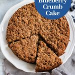Slice of paleo blueberry crumb cake on a plate - square