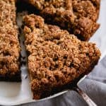 Spatula serving piece of paleo blueberry crumb cake - square