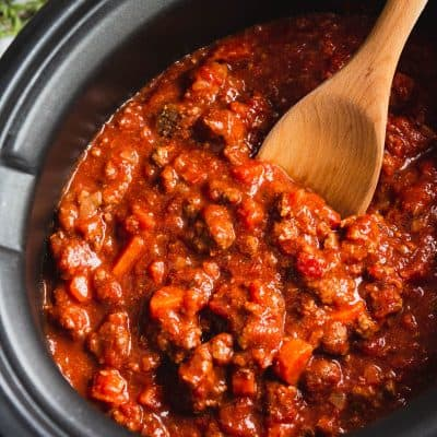 Slow Cooker Bolognese Sauce in a Bowl with a fork