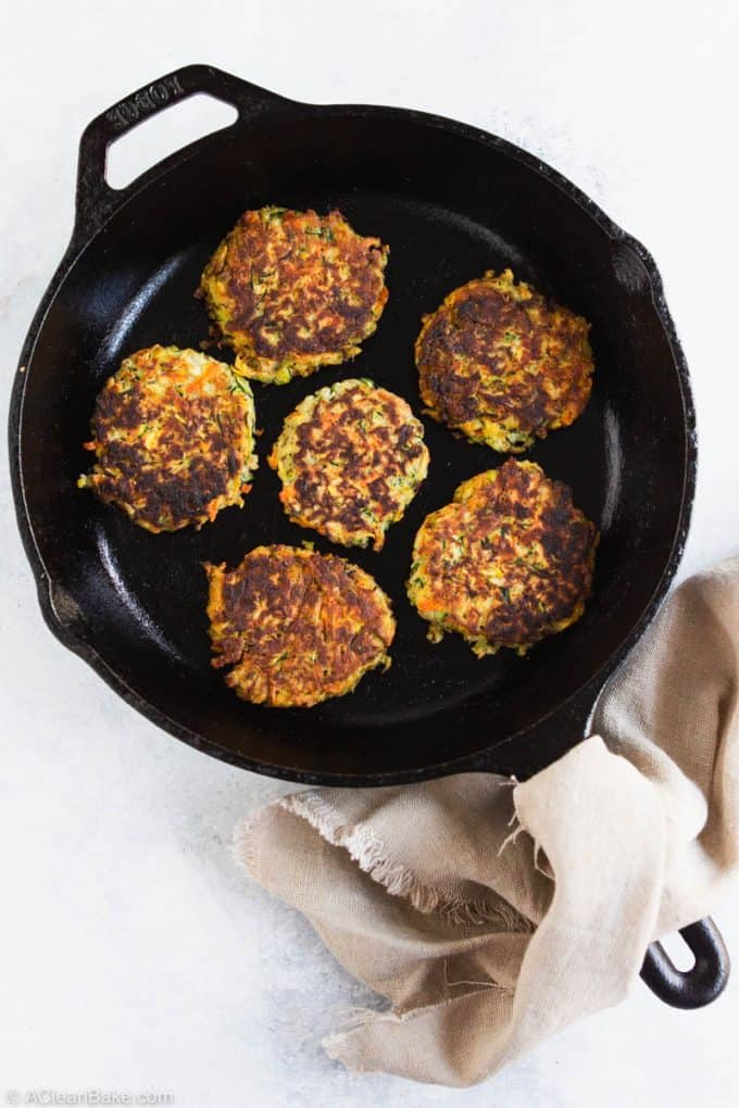 Paleo gluten free vegetable fritters in a cast iron pan