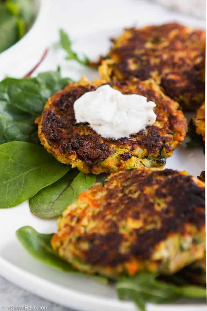 Close up of paleo gluten free vegetable fritter with yogurt sauce