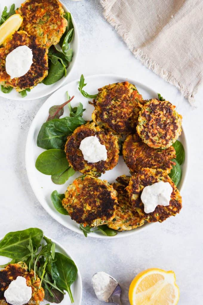 Plate of gluten free vegetable fritters with yogurt sauce