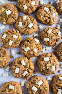 Gluten free & Paleo Pistachio White Chocolate Chunk Cookies on a blue counter