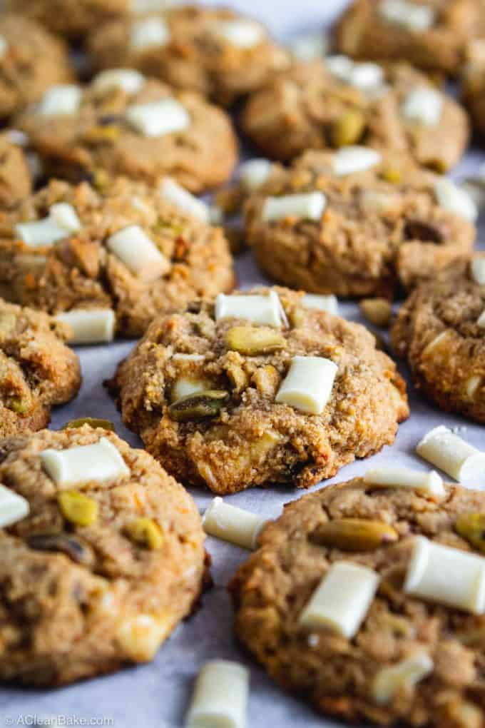 Gluten free & Paleo Pistachio White Chocolate Chunk Cookies on a blue counter