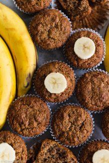 Paleo Gluten Free Banana Muffins next to a bunch of bananas