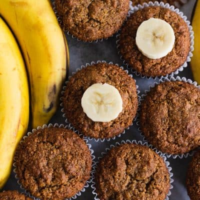 Paleo Gluten Free Banana Muffins next to a bunch of bananas