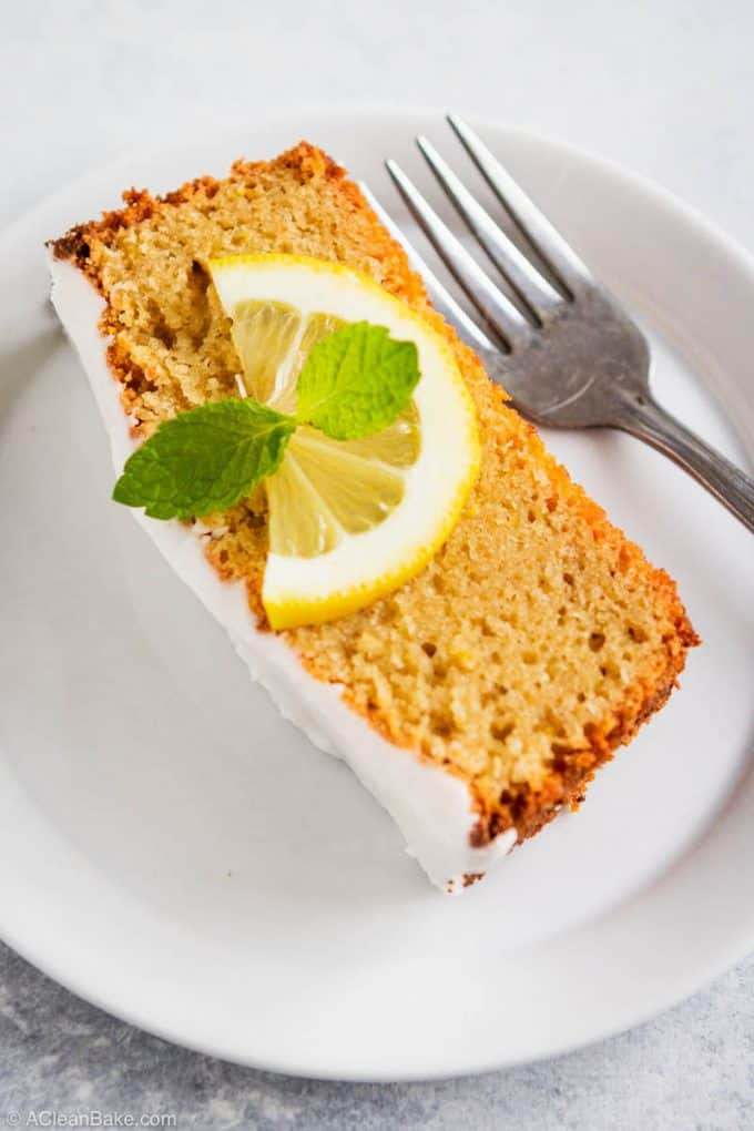 Slice of gluten free and paleo lemon pound cake on a plate with a fork