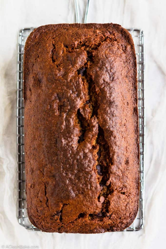 Loaf of paleo gluten free banana bread on a cooling rack