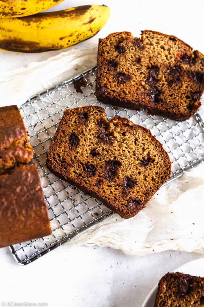 Slices of paleo gluten free banana bread on a cooling rack
