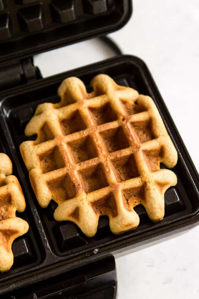 Paleo gluten free waffles in a waffle iron