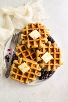 Plate of paleo gluten free waffles with butter