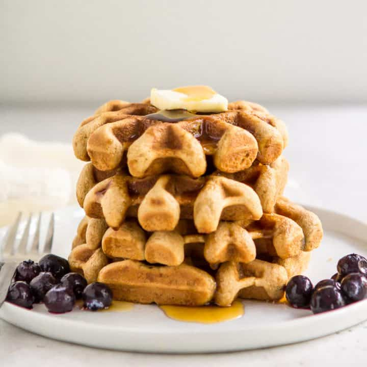 Stack of paleo gluten free waffles on a plate