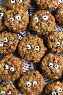 Gluten Free Monster Cookies with Candy Eyes arranged on a cooling rack
