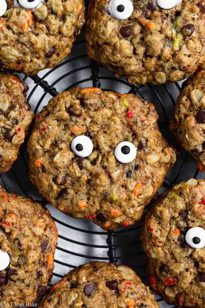 Gluten Free Monster Cookies with Candy Eyes arranged on a cooling rack- Close Up Shot