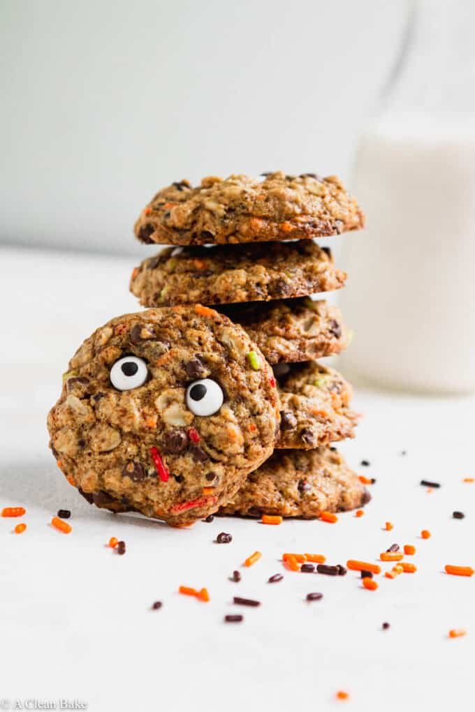 Gluten Free Monster Cookies stacked on a white table