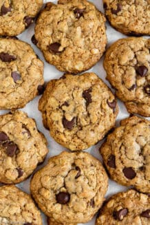 Pile of gluten free oatmeal chocolate chip cookies on a table