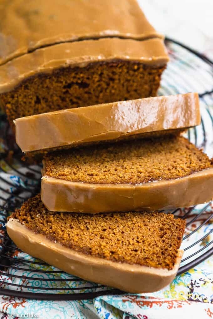 Sliced loaf of gluten free pumpkin bread on a cooling rack