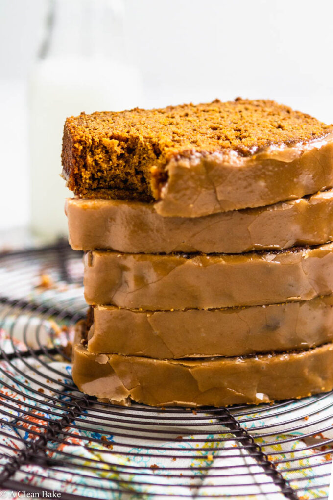 Pile of sliced paleo gluten free pumpkin bread on a cooling rack