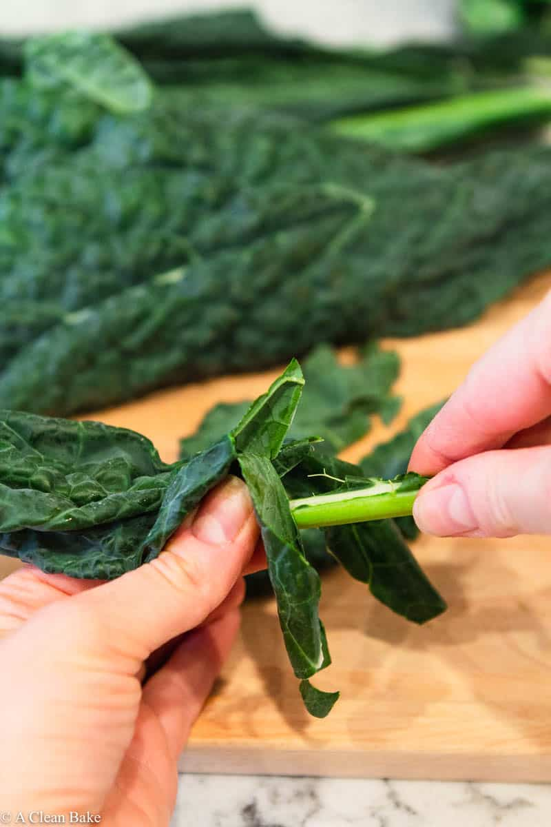 Demonstration of an easy way to remove kale leaves from the stem