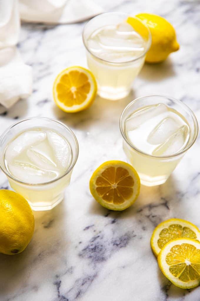 Glasses of Sugar Free Lemonade surrounded by lemons
