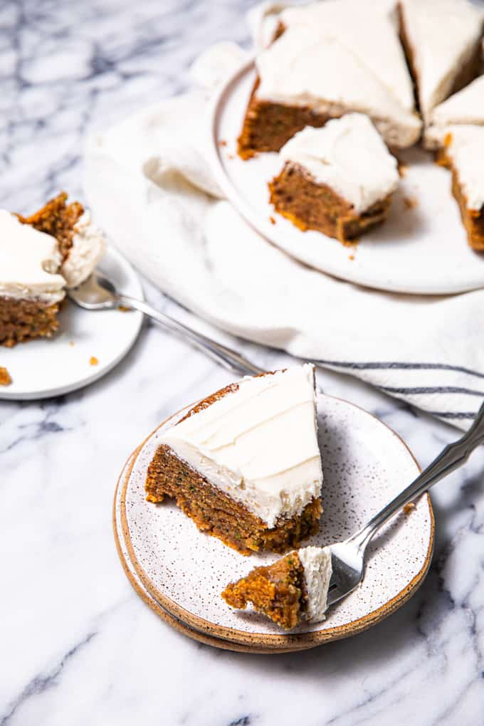 Gluten Free Paleo Zucchini Cake sliced up on a marble table