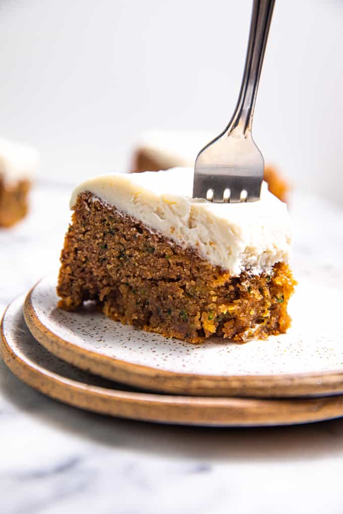 A Slice of Gluten Free Paleo Zucchini Cake on a plate with a fork