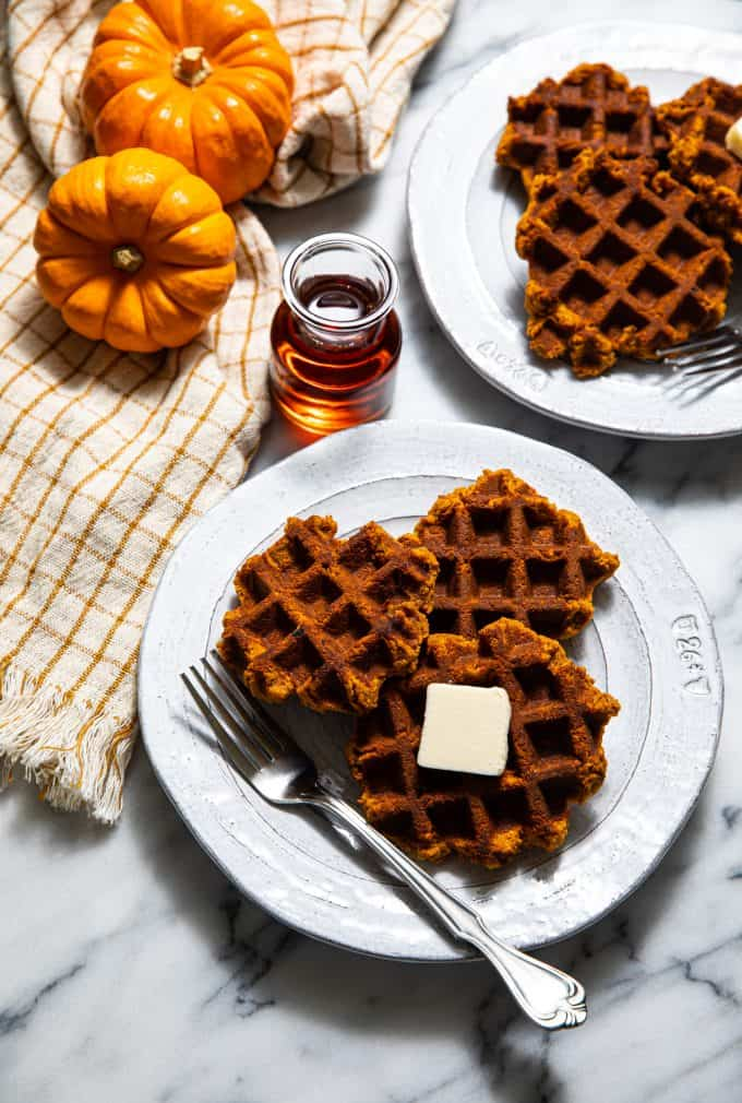Breakfast spread of Paleo and Gluten Free Pumpkin Waffles on two plates