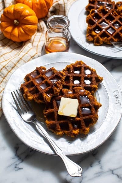 Plate of Paleo and Gluten Free Pumpkin Waffles with butter and syrup and a fork