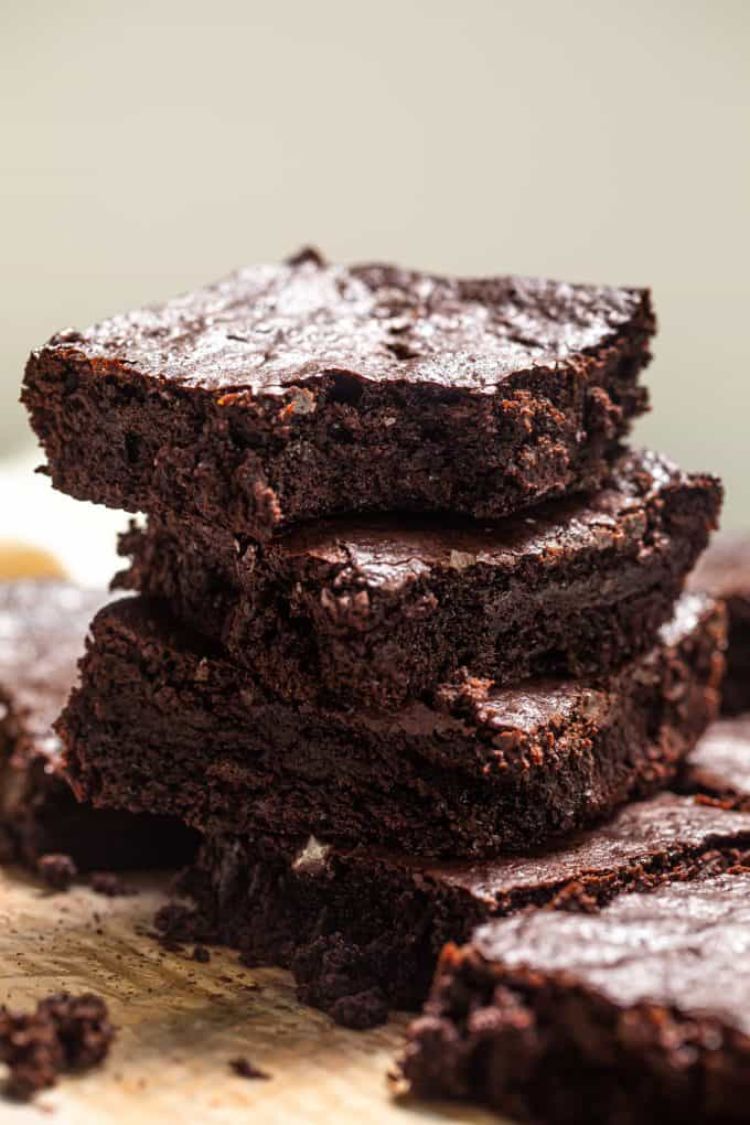 Close up on stack of Paleo Gluten Free Brownies with a bite taken out of the top brownie