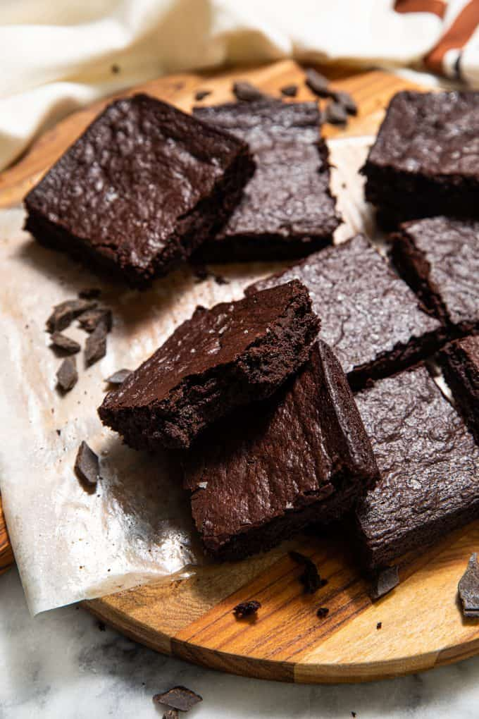 Pile of Paleo Gluten Free Brownies on a board