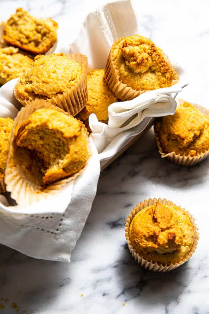 Pile of gluten free corn muffins in a serving basket